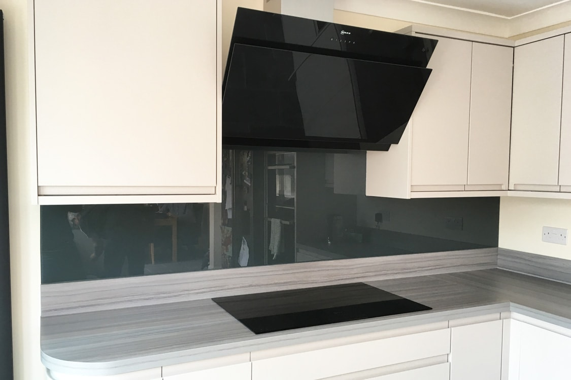 Stunning Kitchen Glass Splashback FInished in Downpipe