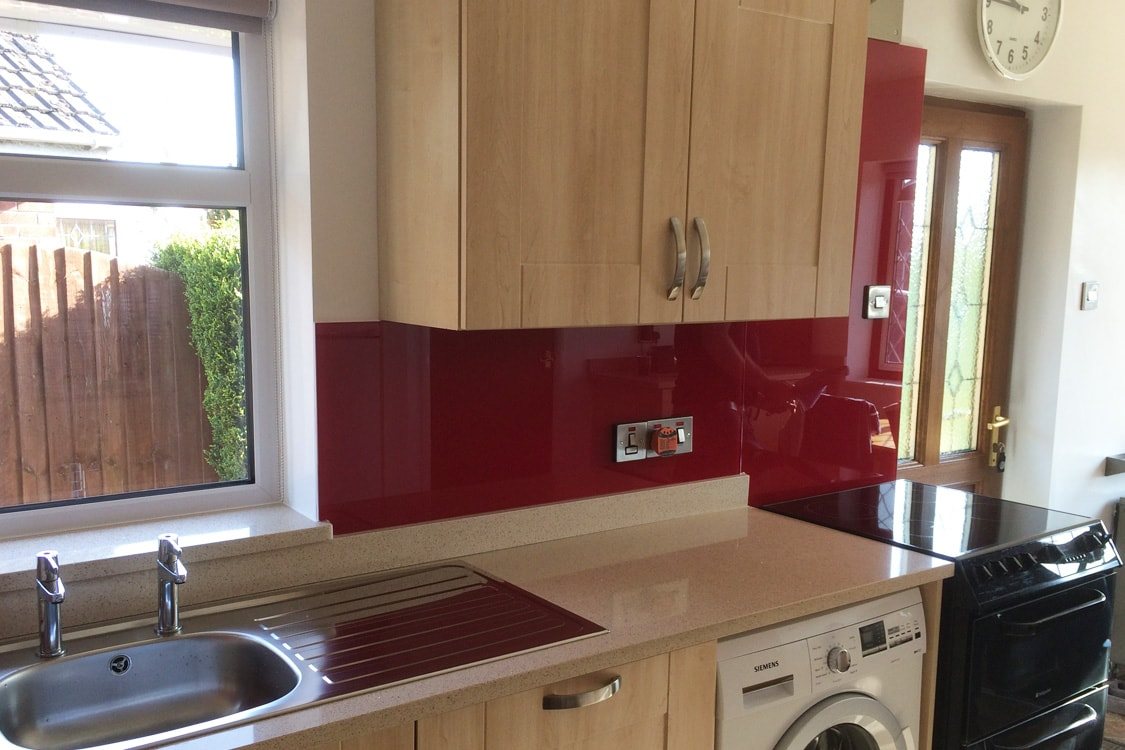 Glass splashback fitted in new kitchen coloured in for Red fitted kitchen