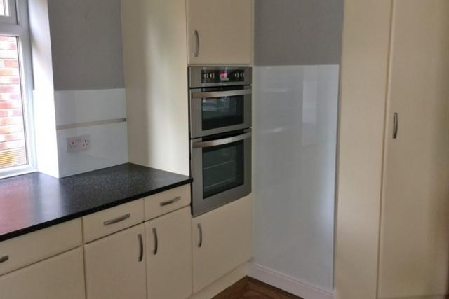 Glass Splashback Set Next to Cooker