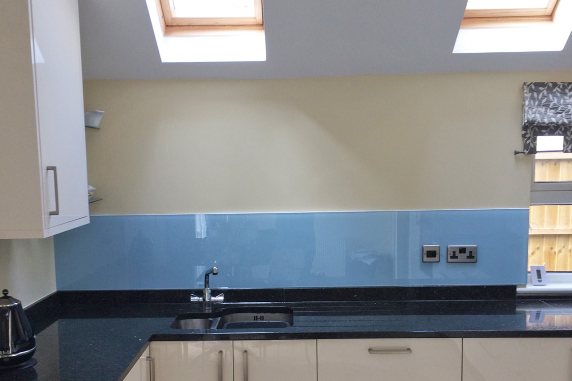 Large Glass Splashback Fitted in Modern Kitchen Coloured in Smeg Blue