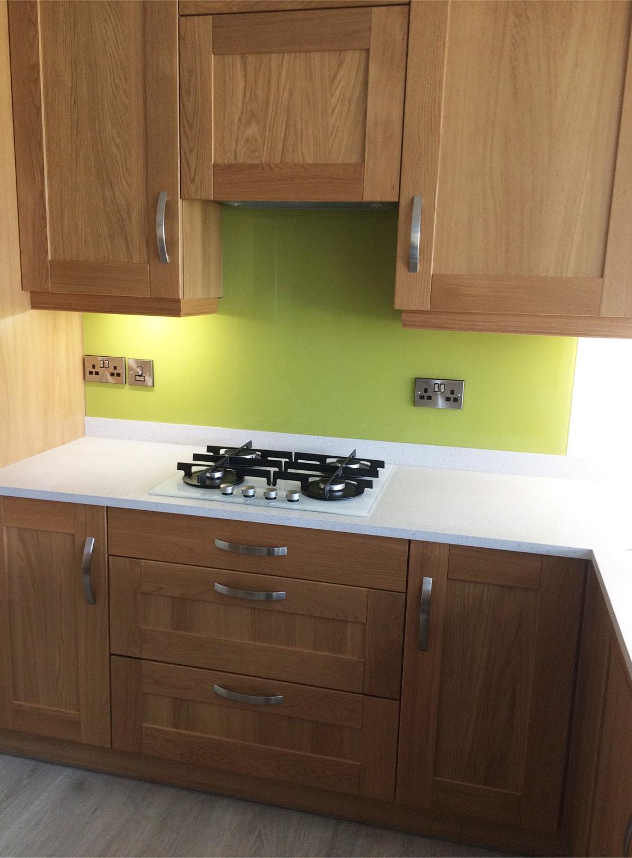 Glass splashback fitted under kitchen cupboards coloured for Fitted kitchen cupboards