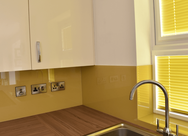 Toughened Glass Splashback In Kitchen Coloured in Hall Yellow